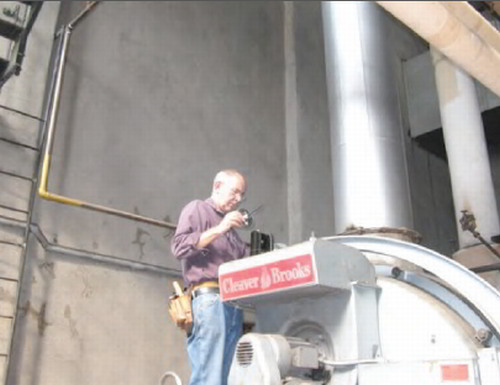 Andrew Rudin at work on an energy audit
